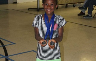 Showing off her track medals