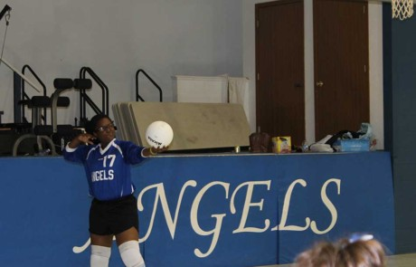 Practicing her volleyball serve