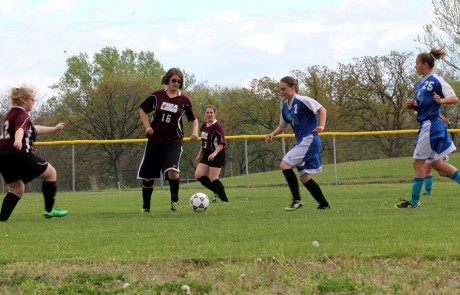 kicking the ball past their opponent